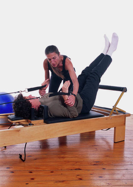 Agile Photograph - Pilates Exercise by Steve Percival/science Photo Library