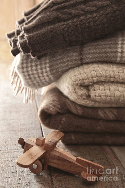 Photograph - Pile Of Wool Blankets With Toy Airplane On Table by Sandra Cunningham