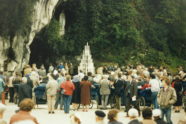 Bernadette Photograph - Pilgrims Gather At The Grotto  Where by Mary Evans Picture Library