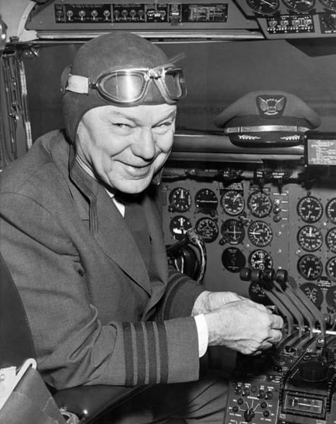 Photograph - Pilot In Airplane Cockpit by Underwood Archives