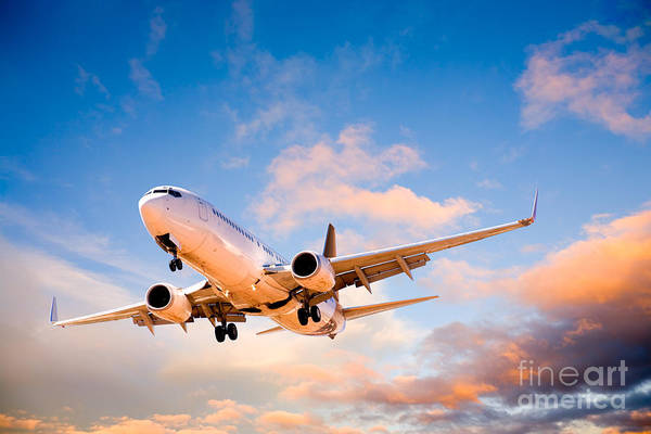 Approach Wall Art - Photograph - Plane Flying In Sunset Sky by Colin and Linda McKie