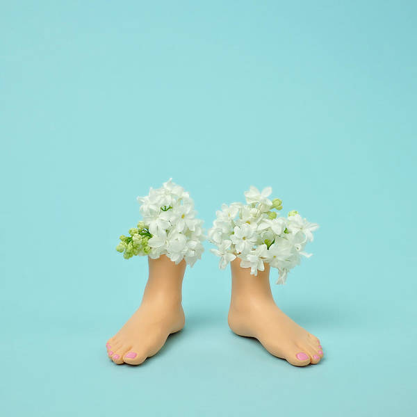 Vase Of Flowers Photograph - Plastic Feet Filled With Flowers by Juj Winn