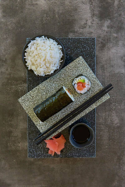 Hand Photograph - Plate Of Sushi With Rice And Pickled by Colin Anderson Productions Pty Ltd