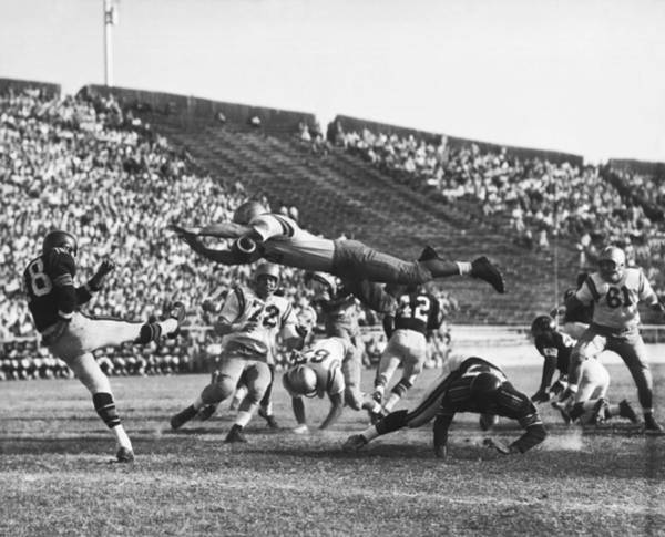 Exertion Wall Art - Photograph - Player Blocks Football Punt by Underwood Archives