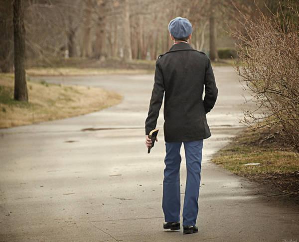 Walking In The Rain Wall Art - Photograph - Poet by Steven Michael