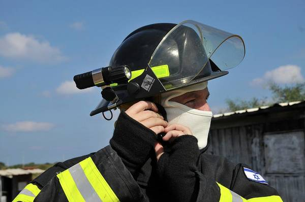 Fire Department Photograph - Portrait Of A Fire Fighte by Photostock-israel