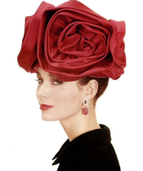 Flower Head Photograph - Portrait Of A Model Wearing A Hat Of Roses by Henry Clarke
