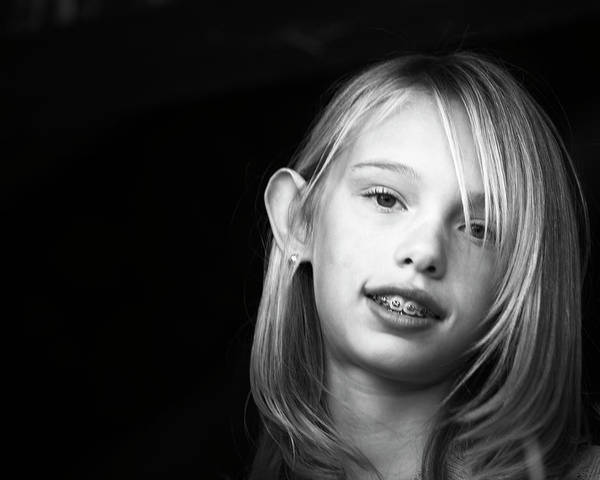 Wall Art - Photograph - Portrait Of A Young Girl by Ron Koeberer