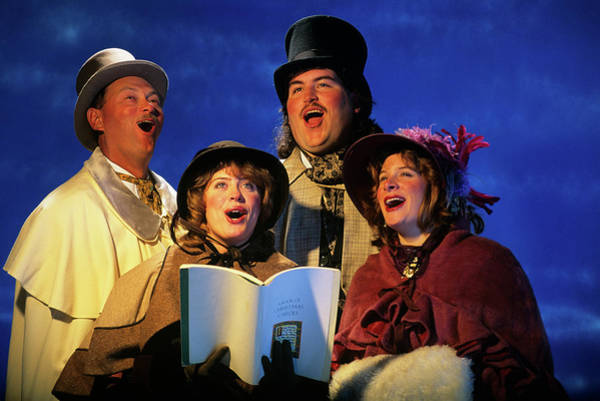 Carol Singing Photograph - Portrait Of Four Christmas Carolers by Vintage Images