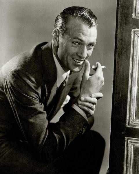 Male Portrait Photograph - Portrait Of Gary Cooper Holding A Cigarette by Lusha Nelson