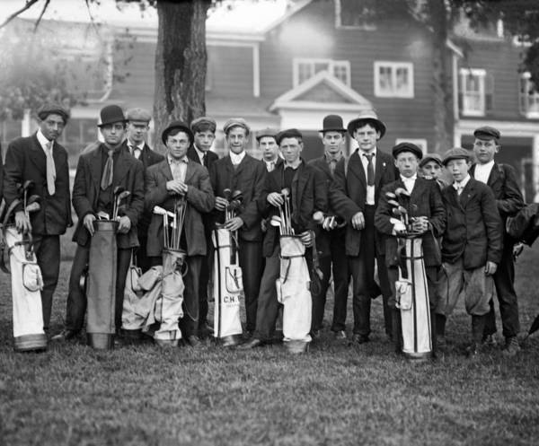 Turn Of The Century Wall Art - Photograph - Portrait Of Golf Caddies by Underwood Archives