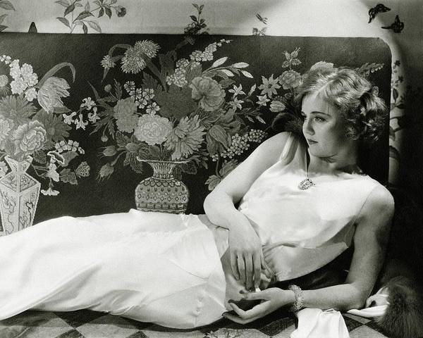 Lying Down Photograph - Portrait Of Nancy Carroll by Cecil Beaton