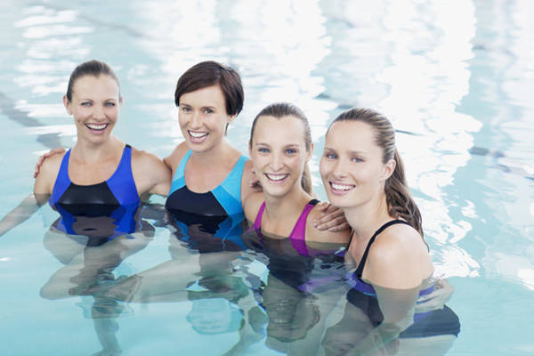 Portrait Of Smiling Women In Swimming Pool Art Print by Robert Daly