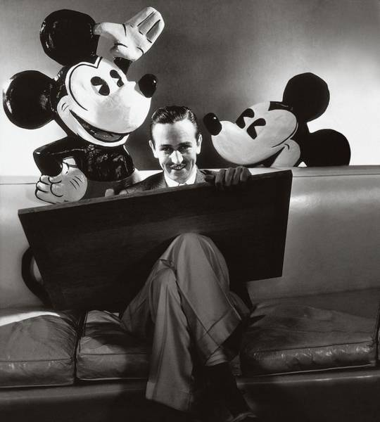 Furniture Photograph - Portrait Of Walt Disney Sitting With Open Cartoon by Edward Steichen
