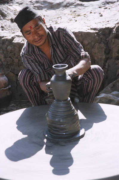 Wall Art - Photograph - Potter At Work In Bhaktapur by Richard Berry