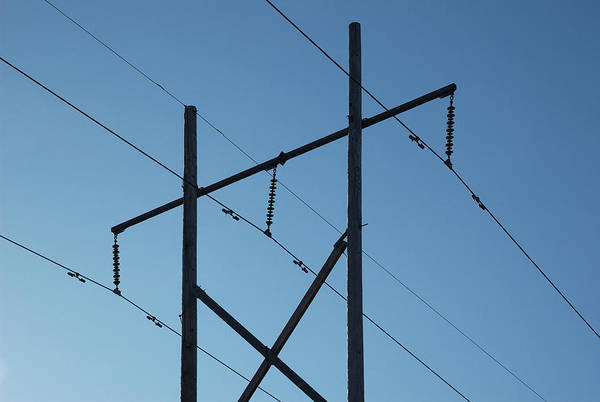 Photograph - Powerlines Silhouetted Against The Blue Autumn Sky by Rob Huntley