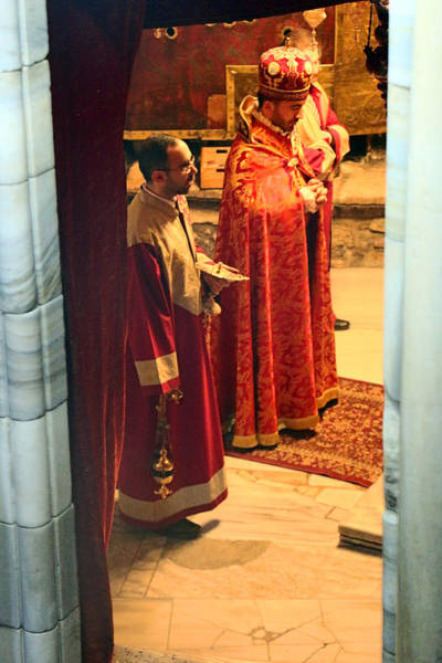 Manger Photograph - Praying At Grotto Manger by Munir Alawi