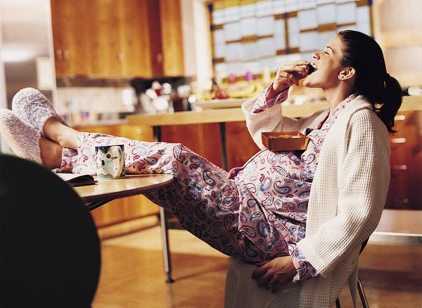 Pregnant Woman Eating Chocolate Art Print by Cohen/Ostrow
