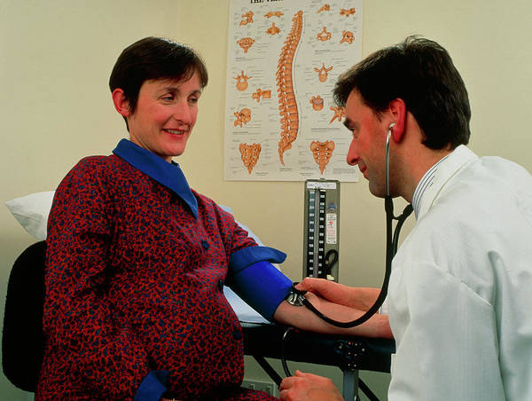 Pregnant Photograph - Pregnant Woman's Blood Pressure Taken By Doctor by Saturn Stills/science Photo Library