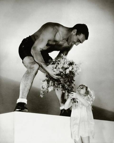 Old People Photograph - Primo Carnera Receiving Flowers From A Little by Edward Steichen