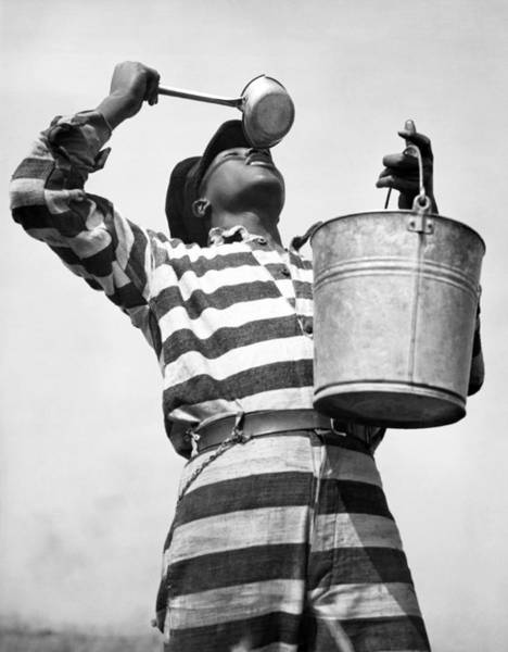 Thoroughfare Photograph - Prisoner Quenches His Thirst by Underwood Archives