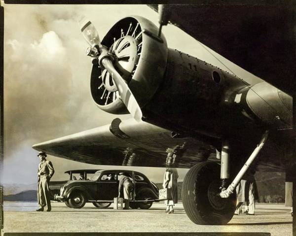 Auto Photograph - Propeller Plane With Passengers And Car by George Hurrell
