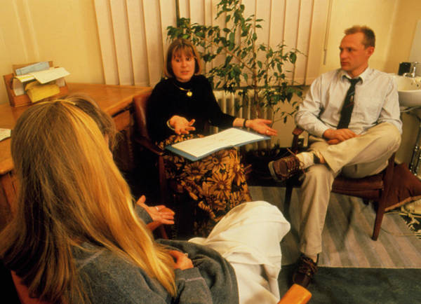 Therapist Photograph - Psychiatric Team Discuss A Patient's Progress by Hattie Young/science Photo Library
