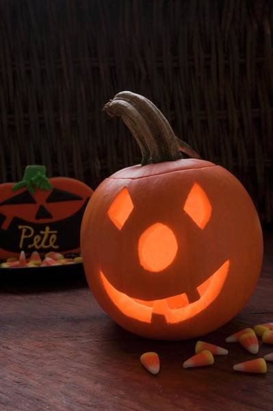 Cucurbit Photograph - Pumpkin Lantern And Sweets For Halloween by Foodcollection