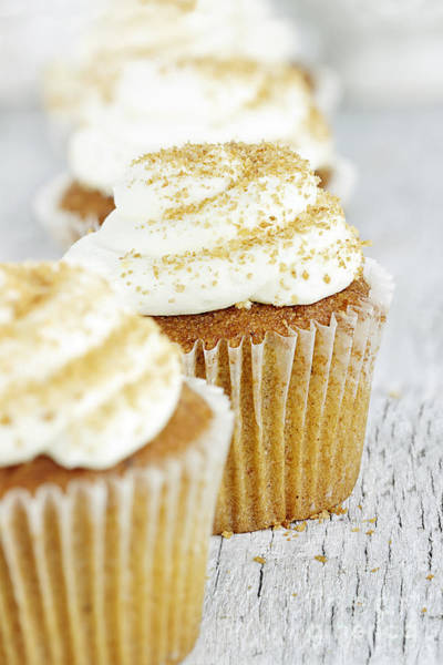 Thanksgiving Photograph - Pumpkin Spice Cupcake With Cream Cheese Icing by Stephanie Frey