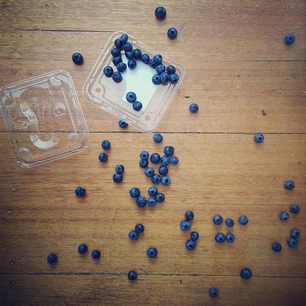 Fruit Photograph - Punnet Of Blueberries Spilt On Wooden by Jodie Griggs