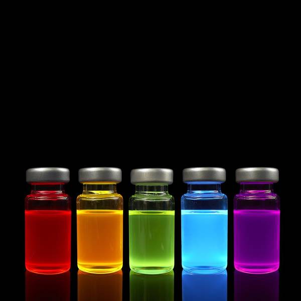 Wall Art - Photograph - Quantum Dot Samples Under Uv Light by Science Photo Library