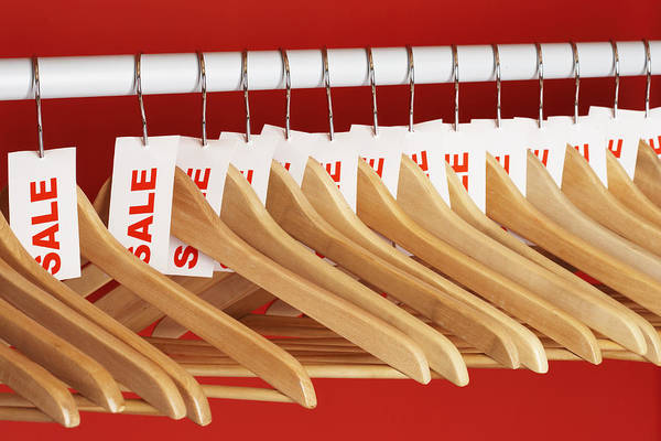 Rail Of Clothes Hangers With Sale Tags Attached, Close-up Art Print by Martin Poole