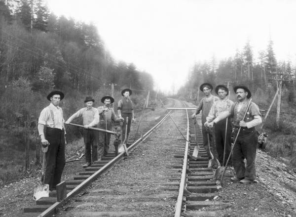 Turn Of The Century Wall Art - Photograph - Railroad Workers by Underwood Archives
