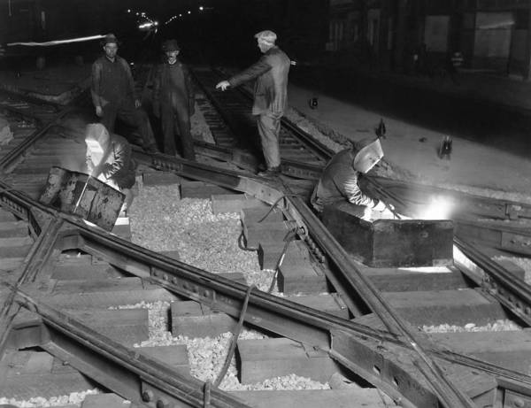 Thoroughfare Photograph - Railroad Workers Welding Track by Underwood Archives
