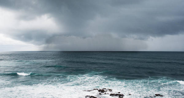 Stormcloud Photograph - Rain Over The Ocean by Parker Cunningham