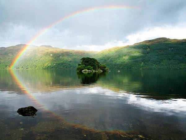 The Trossachs Wall Art - Photograph - Rainbow Over Tarbet Isle On Loch by Feargus Cooney