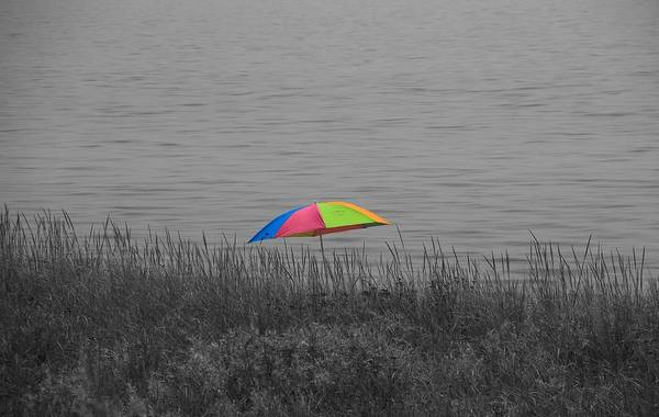 Laying Out Photograph - Rainbow Umbrella At The Beach by Dan Sproul