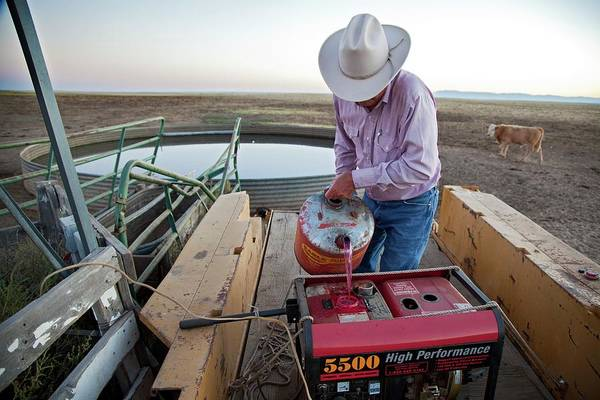 Generators Photograph - Rancher Filling Generator With Diesel by Jim West