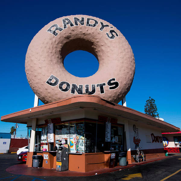 Road Sign Photograph - Randy's Donuts by Stephen Stookey
