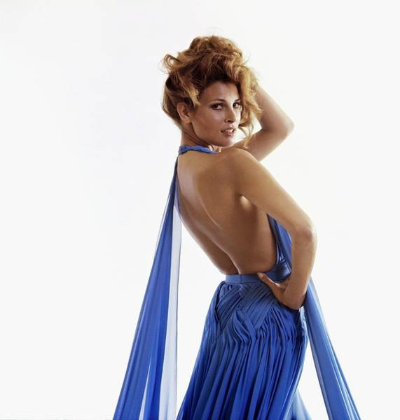 Blue Gown Photograph - Raquel Welch Wearing A Valentino Dress by Henry Clarke