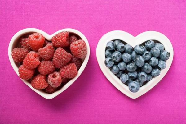 Wall Art - Photograph - Raspberries And Blueberries In Heart-shaped Dishes by Foodcollection