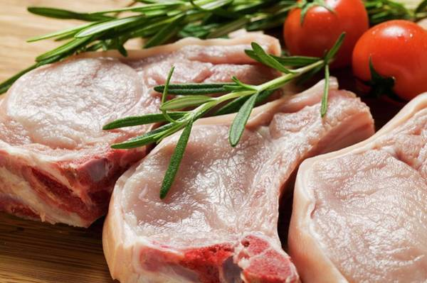 Vegies Photograph - Raw Pork Chops With Rosemary And Tomatoes by Foodcollection