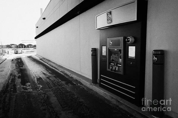 Thru Photograph - rbc drive through atm outside bank in winter Saskatoon Saskatchewan Canada by Joe Fox