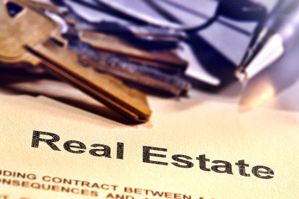 Photograph - Real Estate Title Word On A Realtor Contract Page by Olivier Le Queinec