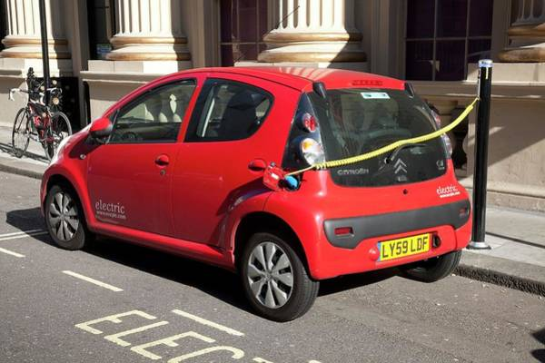 Plug-in Photograph - Recharging An Electric Car by Mark Thomas/science Photo Library