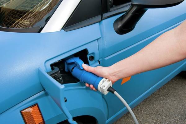 Plug-in Photograph - Recharging An Electric Car by Philippe Psaila/science Photo Library