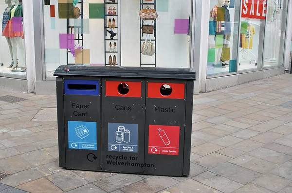 Rubbish Bin Photograph - Recycling Bins In Front Of Fashion Shop by Robert Brook/science Photo Library