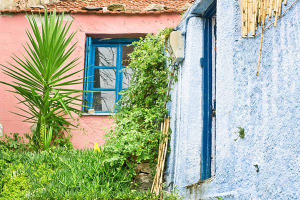 Old Wall Art - Photograph - Red And Blue Houses by Tom Gowanlock