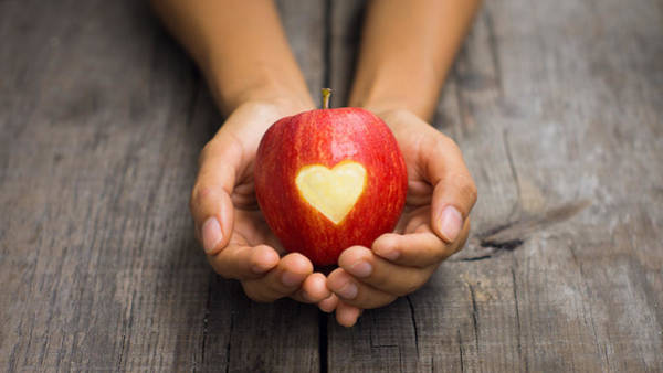 Wall Art - Photograph - Red Apple With Engraved Heart by Aged Pixel