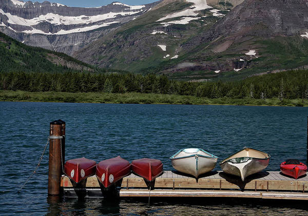 Sandra Anderson Wall Art - Photograph - Red Canoes On The Lake by Sandra Anderson